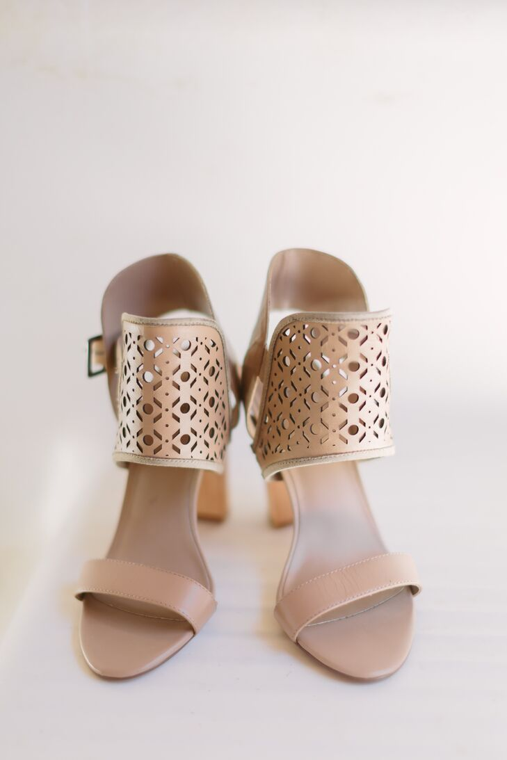 Megan wore one-of-a-kind brown shoes with a thick patterned strap going around the ankles. The neutral color fit in with the rest of the wedding day hues.