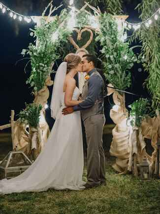 Romantic outdoor wedding arch with fairy lights