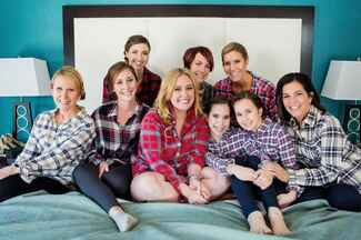 Bride and her bridesmaids getting ready in flannel button downs