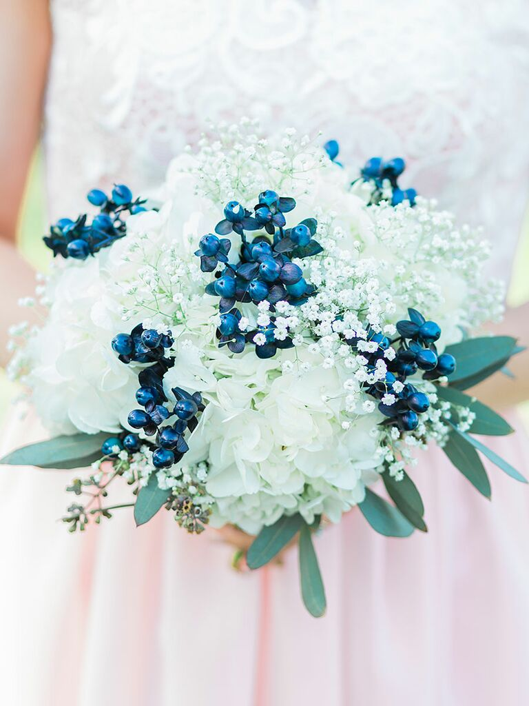 The best blue wedding flowers and 16 gorgeous blue bouquets blue and white wedding bouquet with hydrangea babys breath and berries junglespirit Images