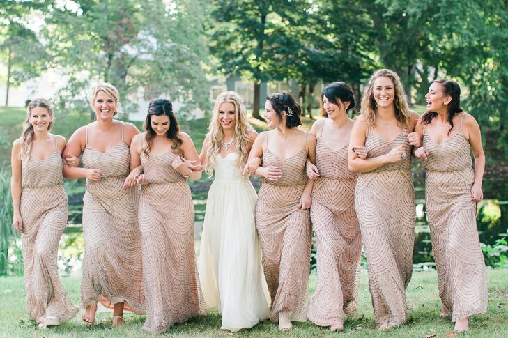 Amanda's bridesmaids opted for taupe, beaded blouson gowns by Adrianna Papell.
