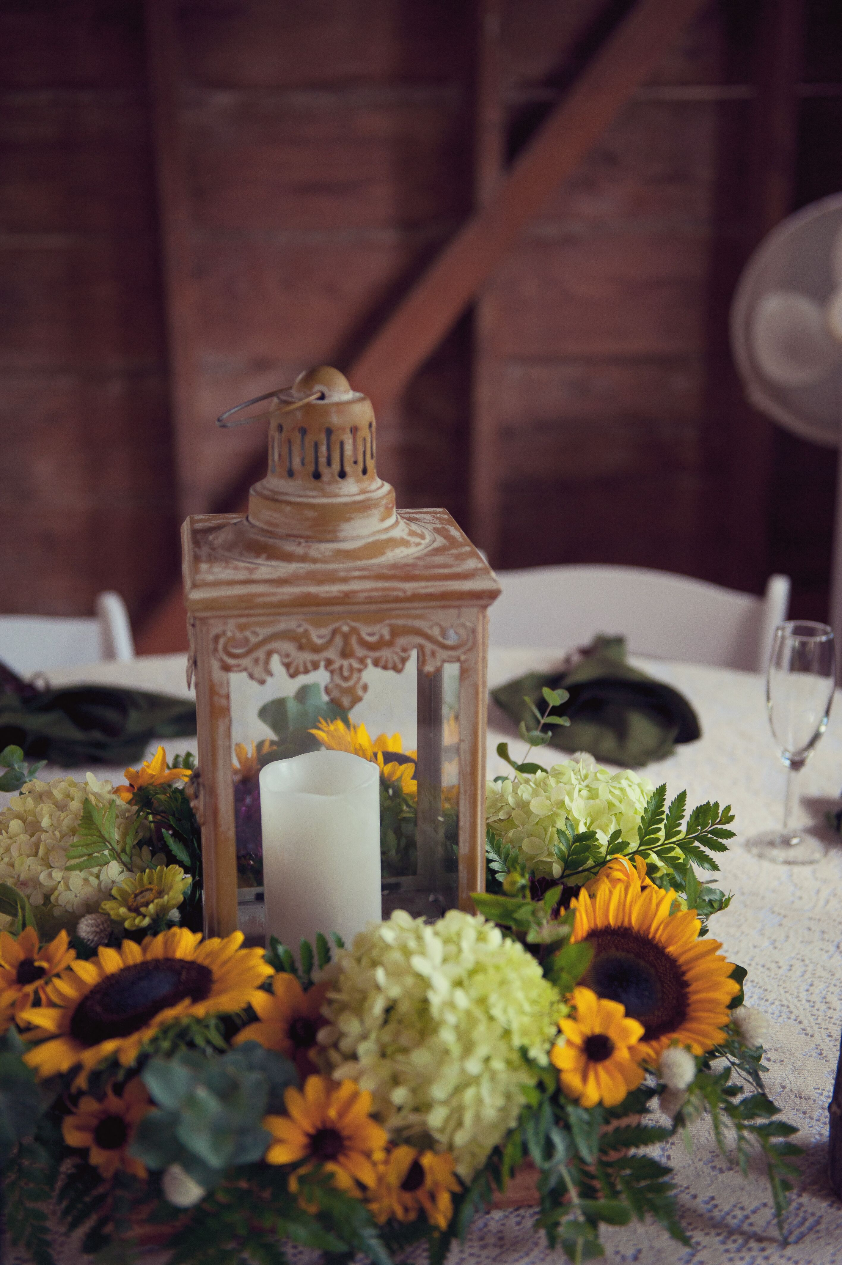 Centerpieces With Lanterns And Sunflowers