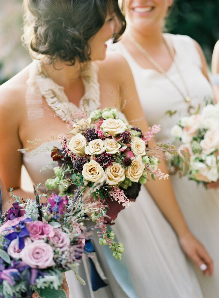 Bridesmaids carried bouquets full of rich color: burgundy, ecru, blush, lilac and fushia in a variety of florals.