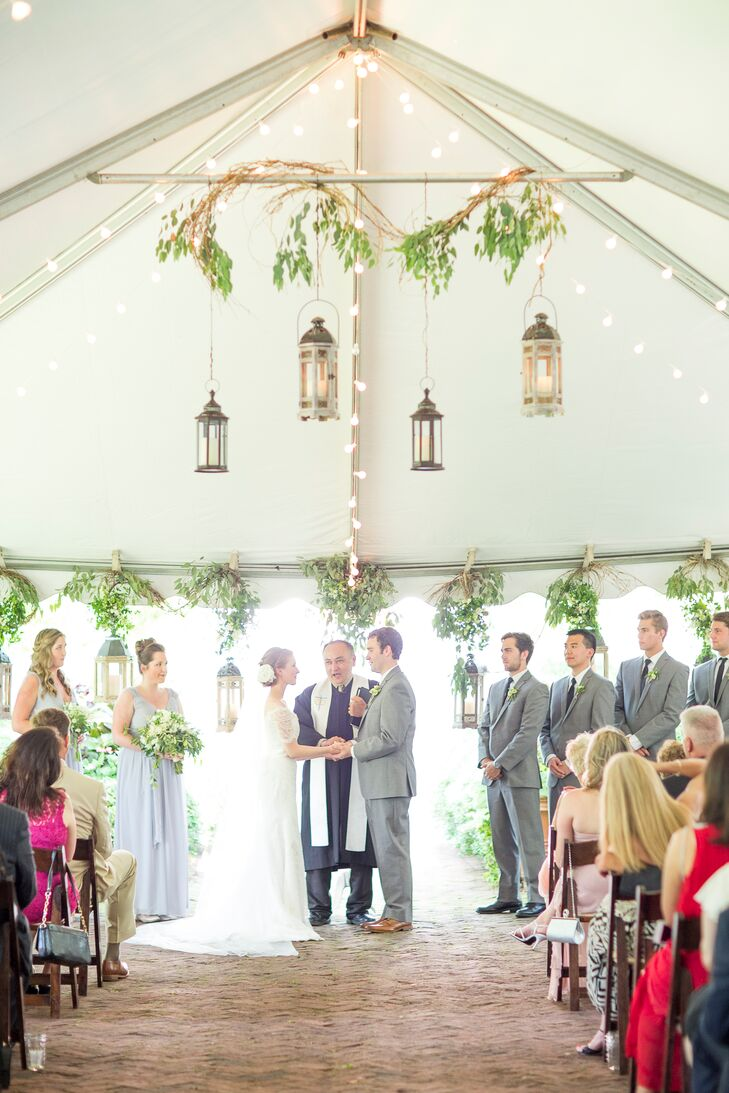 Faith and Brent's ceremony took place under a white tent decorated with string lights and greenery  at Ships of the Sea Maritime Museum in Savannah, Georgia. Overhead, a branch with hanging greenery and lanterns enhanced where they stood to exchange their vows.