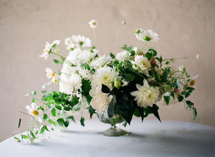 White dahlia and greenery floral arrangement