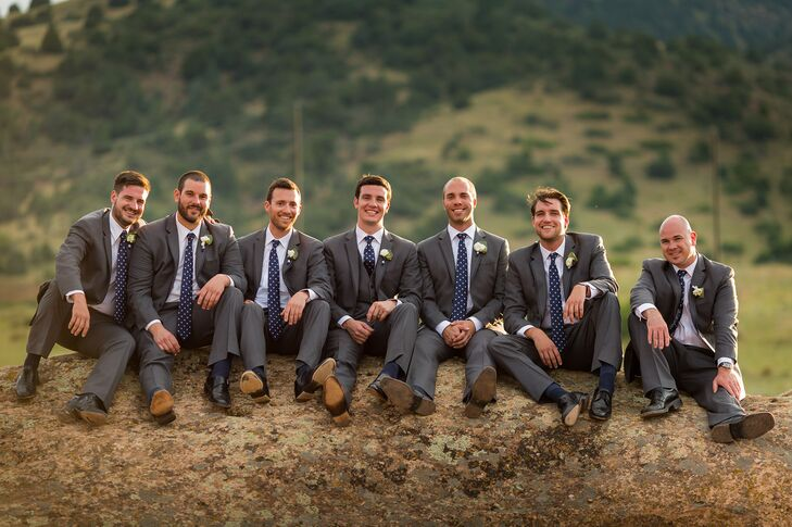 The groomsmen wore charcoal Vera Wang tuxes with navy and white polka dotted ties.