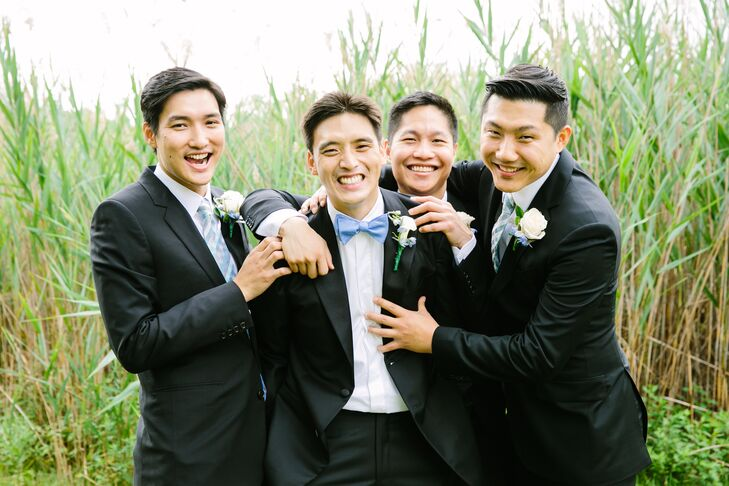 """It ended up being incredibly difficult to find ties for the groomsmen as J Crew actually didn't sell ties that matched back to the dresses,"" says Jenny. ""I wanted a printed tie and ended up finding a checkered tie that matched the dresses from Bows 'n Ties that wasn't too matchy-matchy."""
