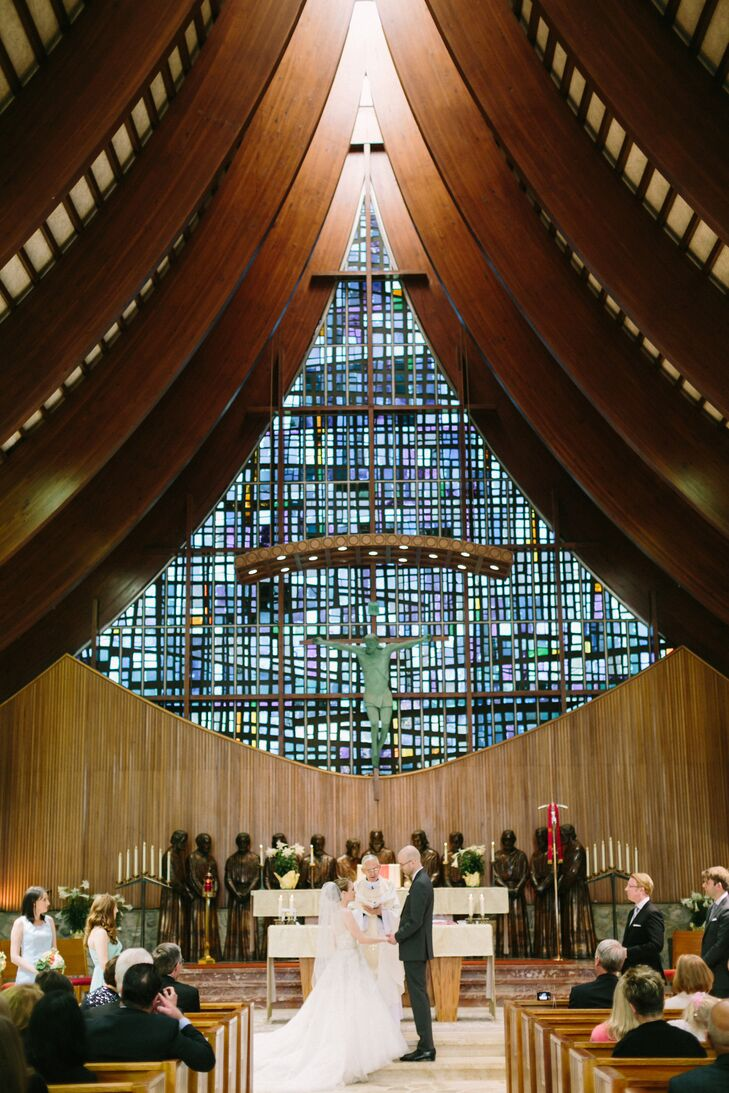 "The couple had a traditional Catholic Mass at St. Mary's Shrine Chapel of Our Lady of Orchard Lake. ""We loved the beautiful stained glass,"" Sarah says."