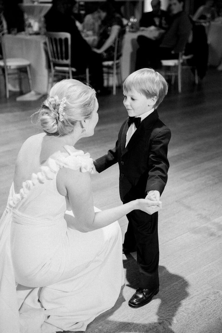 """I had a very special dance with my ring bearer,"" Lynn says. ""His favorite movie—along with every other 4-year-old—is Frozen. I knew he would be jet-lagged from flying from Belgium two days prior, and maybe self-conscious about dancing with me in front of a crowd, so I wanted him to be as comfortable as possible.  We danced to 'Love Is an Open Door' from the 'Frozen' soundtrack, and he sang and danced the whole time. Afterward, he was so comfortable that he became the star of the dance floor for the rest of the night. The next day, he told his mom he wanted to go back to the wedding."""