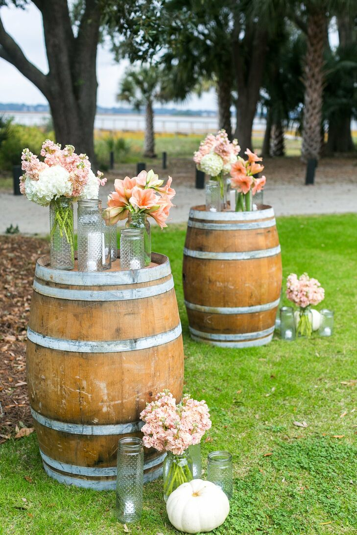peach ceremony flowers and mason jar candles