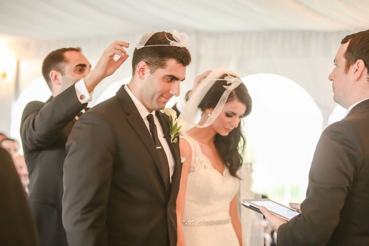 "Alina and Nick chose to have their ceremony and Greek Orthodox stefana crowning tradition under a classic white tent at Safety Harbor Resort and Spa. ""Even though we weren't getting married in the Greek church, we wanted to intimacy churches offer,"" says Alina. The couple lined their ceremony with all white florals as 125 friends and family members watched from rows of white chairs."