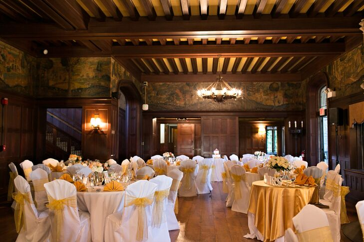 The Waveny House grand hall played host to the reception. The 19th century wood paneled walls, hand-stenciled murals, marble fire places and original wooden floors infused the space with old world charm, setting a traditional tone for the rest of the decor. The couple struck the perfect balance of contemporary and classic, opting for a palette of gold, peach, pink and coral hues and topping the tables with fresh blooms like roses, hydrangeas and hypericum.
