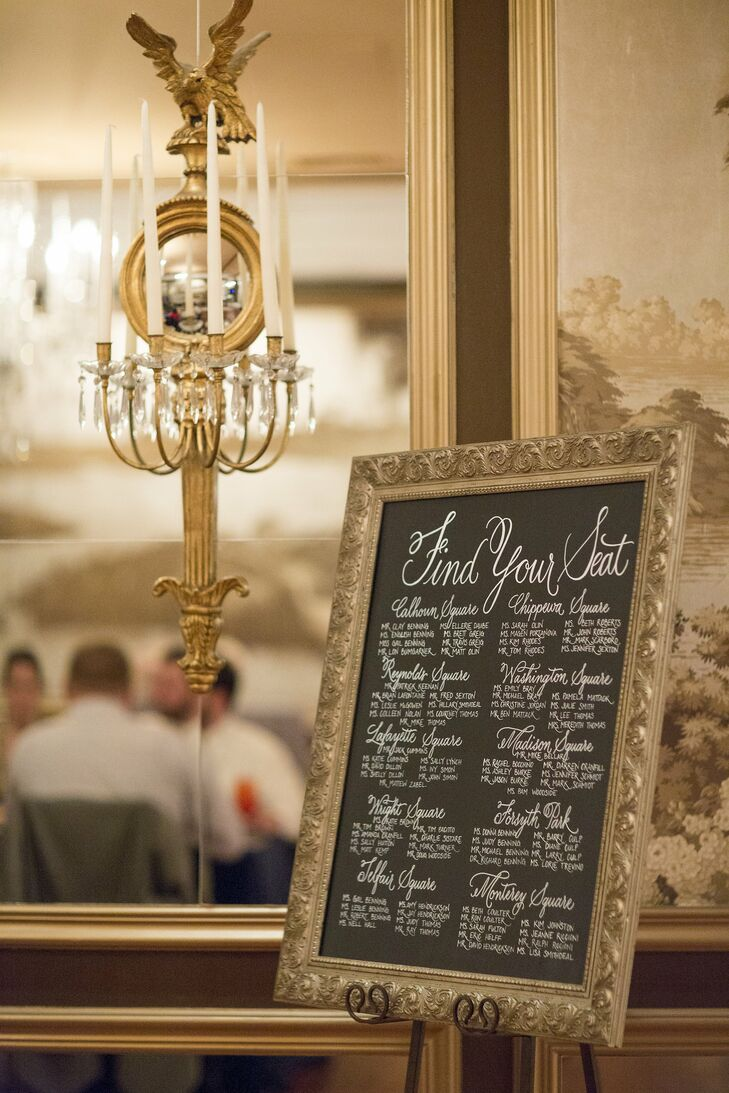 The couple named the tables after the squares of Savannah, and used an elegant seating chart to tell guests where to go.
