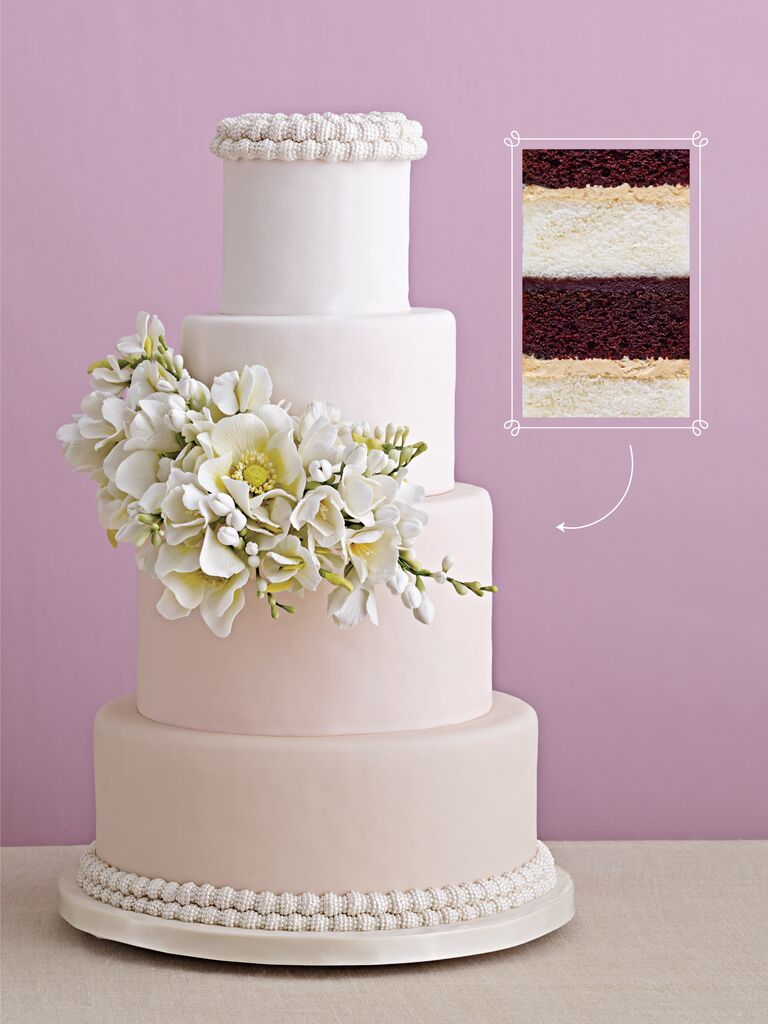 ombre ivory to blush wedding cake with a cascade of sugar flowers