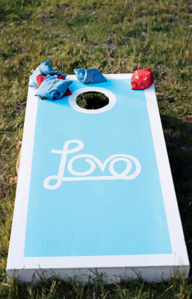 blue and white DIY cornhole game