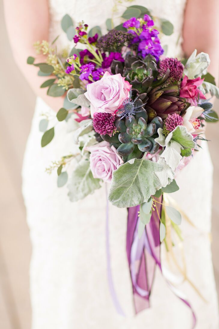 Katie's oversize bouquet was a mix of purple roses and green succulents.