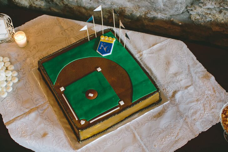 In addition to the couple's four-tiered classic wedding cake, Jeff's grandmother surprised the pair with a homemade confection designed in the likeness of the Kansas City Royals' — Jeff's favorite team — home field.rn