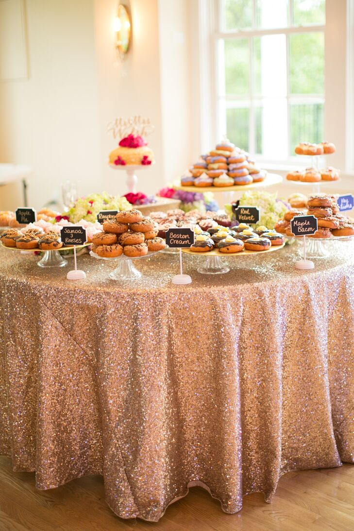 doughnut dessert display with chalkboard signs