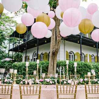 Wedding venue decorated with lanterns, tables adorned with candles