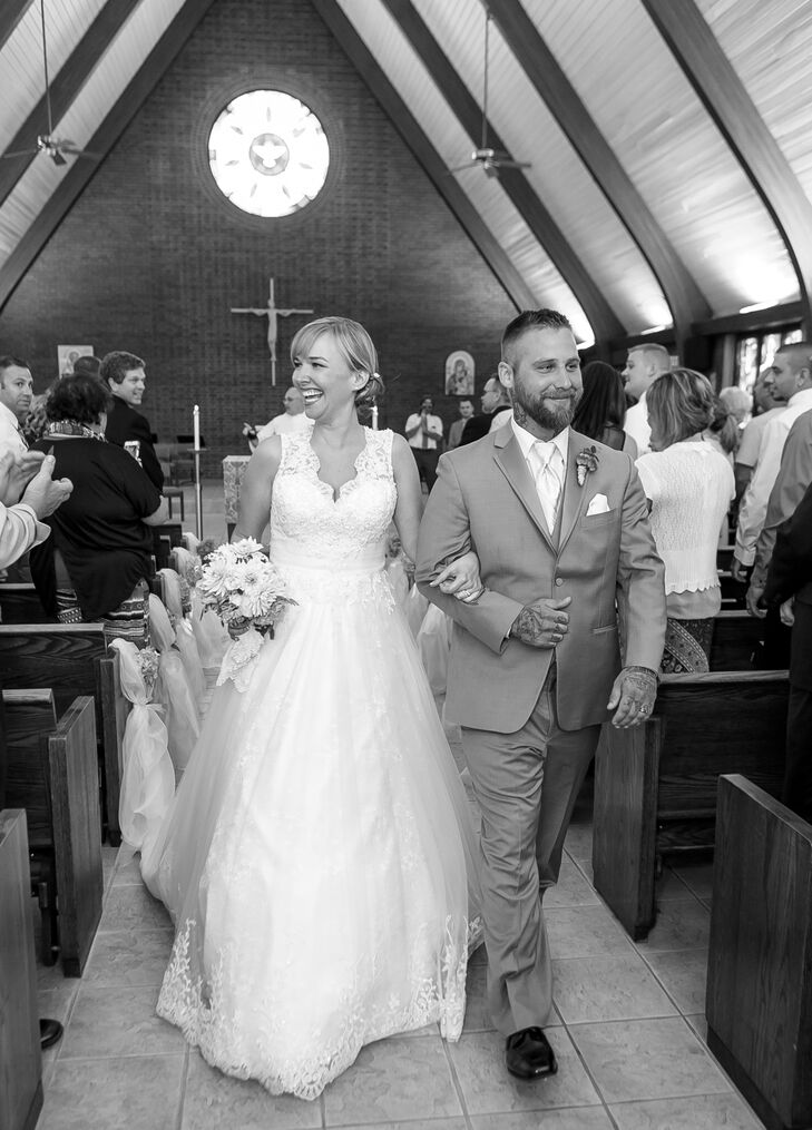 Megan and Clint walked back up the aisle after their ceremony was finished inside the University Parish Newman Center in Kent, Ohio.