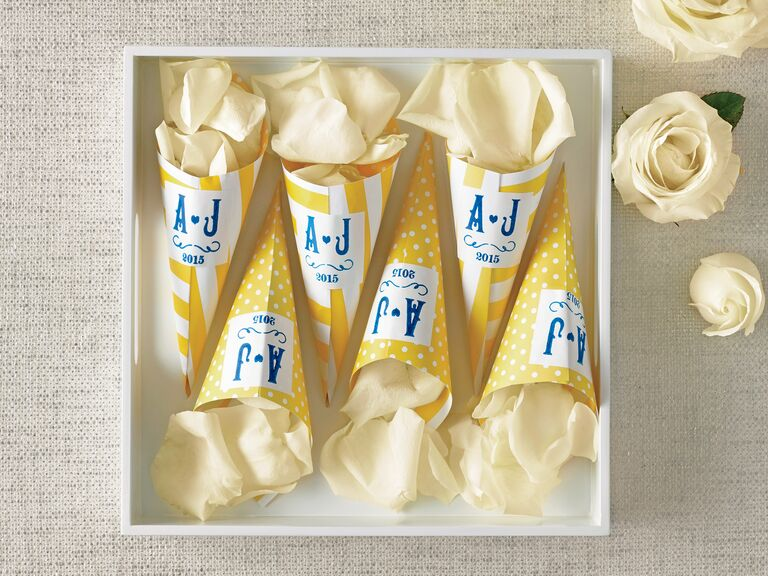 White rose petal confetti cones for wedding ceremony