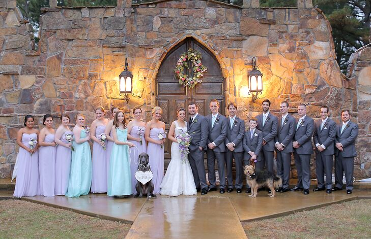 The bridesmaids wore strapless, floor-length chiffon dresses in lavender and mint. The groom and groomsmen wore dark gray tuxedos with vests. Even the couple's dogs dressed up for the occasion.