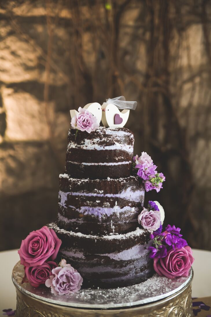 naked chocolate wedding cake with purple filling