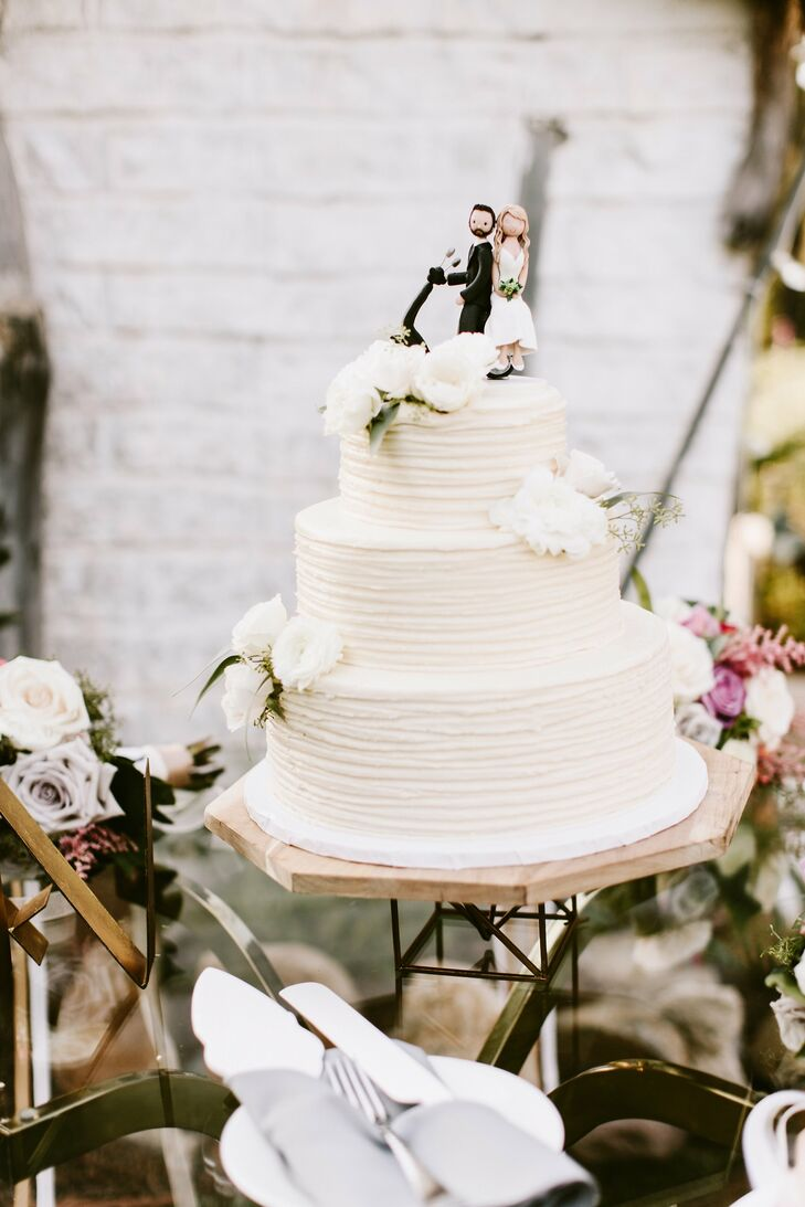 Mira and Nate's wedding cake from Susiecakes was crowned with a custom topper of a couple on a Vespa—Nate picked Mira up in one for their first date.