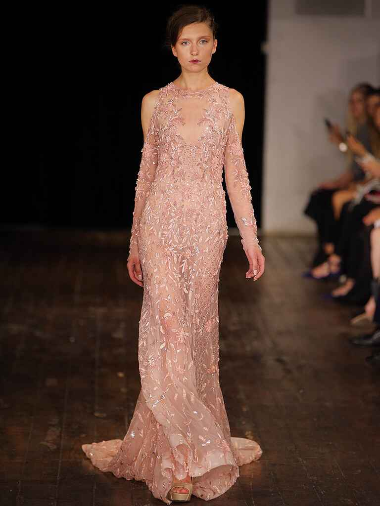 ​Blush pink long sleeved wedding gown by Rivini​​