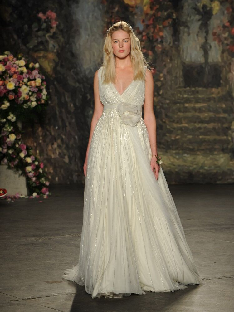 Jenny packham debuts wedding dress collection for bridal fashion week jenny packham a line wedding dress with vertical sequins and big floral sash from spring junglespirit Choice Image