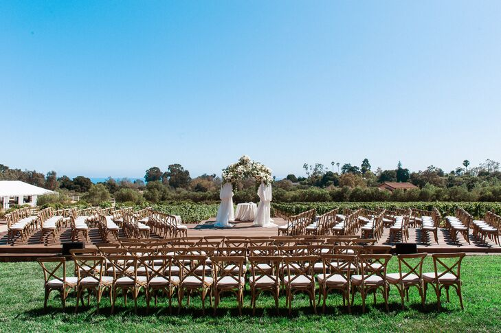 """The ceremony chuppah was raised up on a custom-built wooden deck that made the ceremony feel more intimate,"" Alyssa says. ""The seats were set up in a semicircle around us, which I highly recommend for shy brides."""