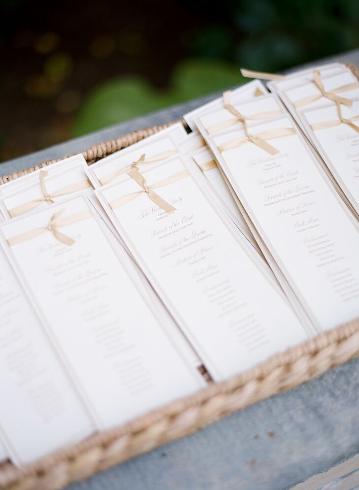 Katie and Dave took the classic route when it came to the ceremony programs, working with Ana Dolan to create an elegant ivory option with gold script and champagne-colored ribbons.