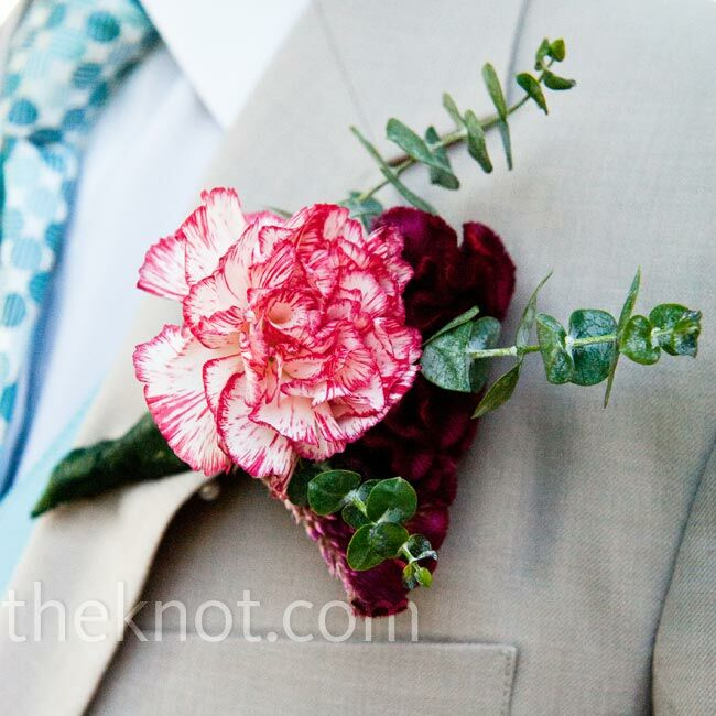 Russ wore a red-tipped carnation and blue eucalyptus and his groomsmen sported red gerbera daisies on their lapels.