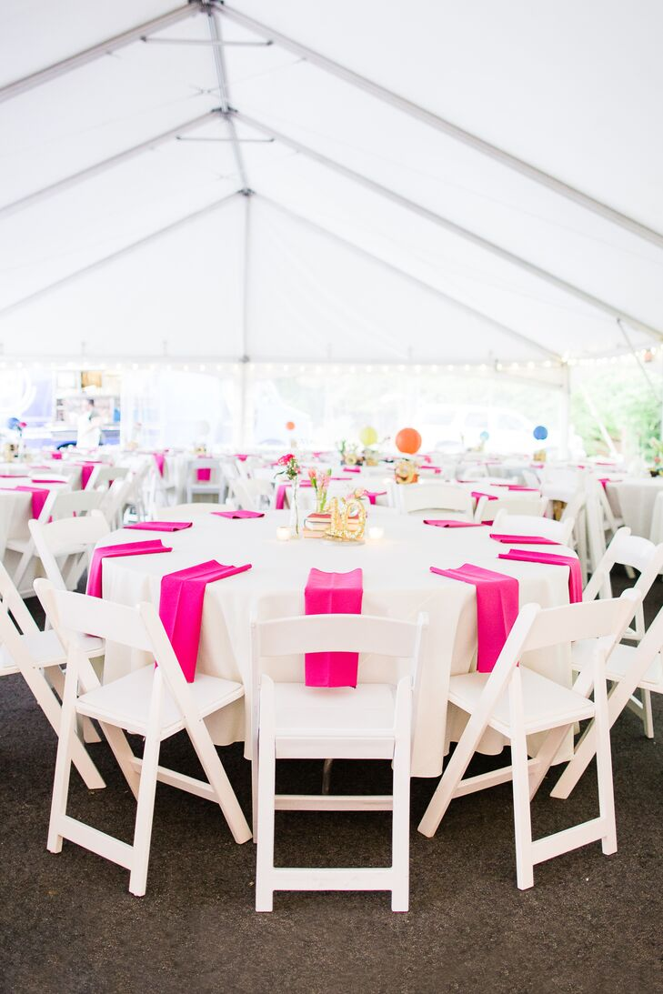 Sophia and Jake didn't want their reception to be too fussy. They kept the decor to a minimum with simple hot air balloon centerpieces and hot pink linen napkins to add a pop of color and whimsy to the otherwise white reception.