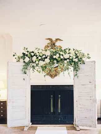 Think outside the arch, pull inspiration from your wedding theme like using stunning vintage doors to frame the ceremony