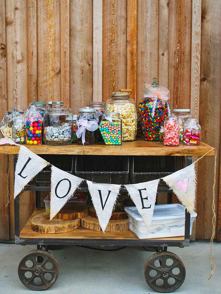 Wedding reception candy bar setup on an antique cart