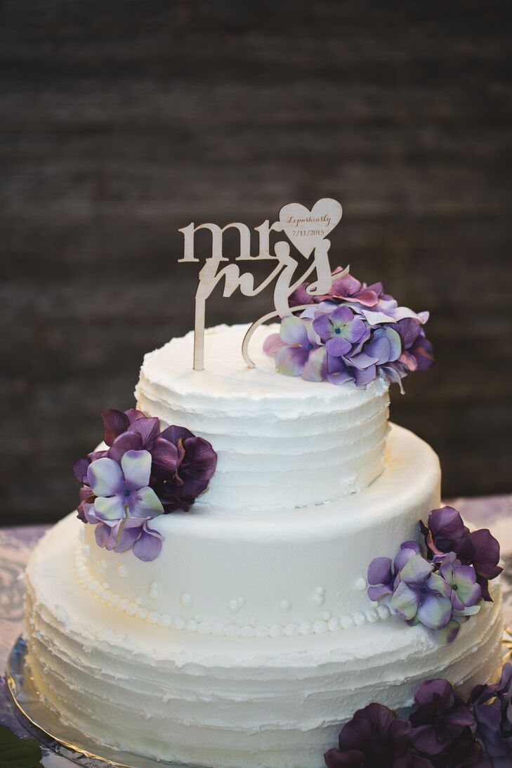 Two-Tier White Wedding Cake With Purple Flowers