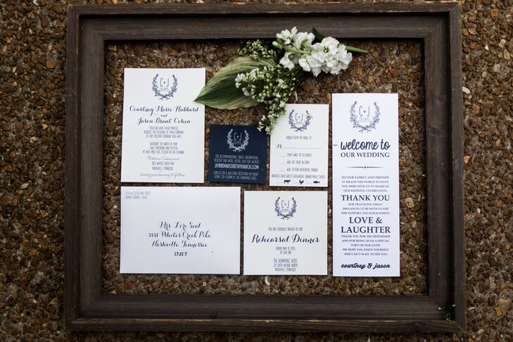 Courtney and Jason's modern-rustic wedding invitations and paper goods were created by Designs in Paper.