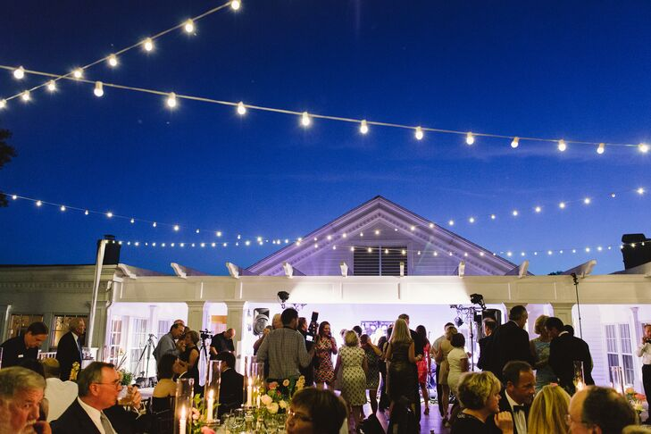 "Katie was set on the idea of having string lights below a starry sky over the dance floor. ""I will never forget seeing the tables and lights all set up on the deck overlooking Lake Calhoun with the Minneapolis skyline in the background. It was magic!"" says the bride."