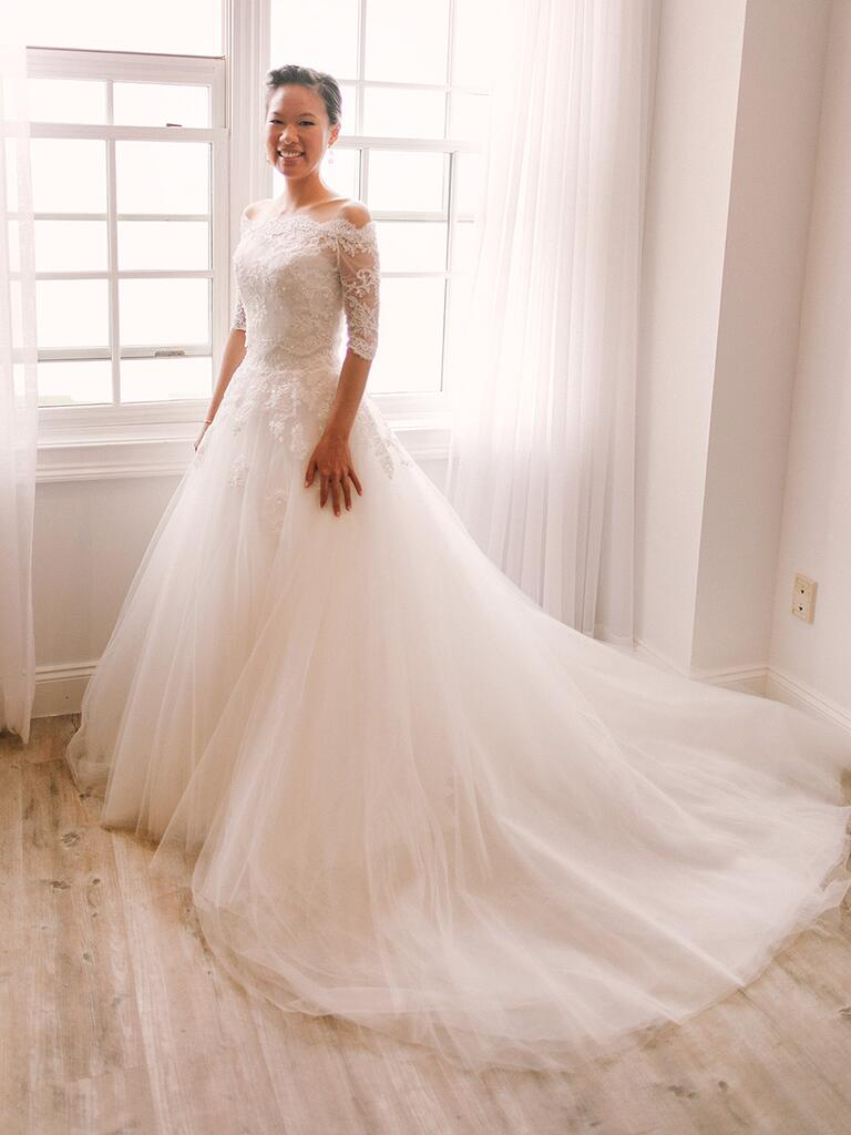 Off-the-shoulder lace bodice wedding gown with full tulle skirt custom by Helene Bridal