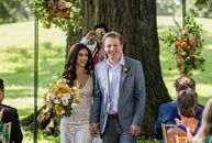 "Gia Rodriguez and Kurt Knisely celebrated their love with a ceremony beneath an arch with minimal flower arrangements at Schiller Park. ""We both love"