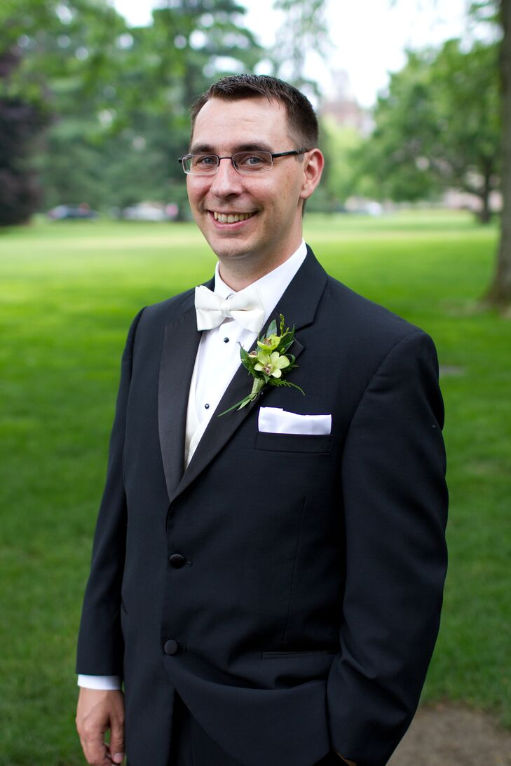 Ben wore a traditional black Calvin Klein tuxedo to match his groomsmen with a crisp white bow tie. He wore a green orchid boutonniere, while his groomsmen wore hot pink roses.