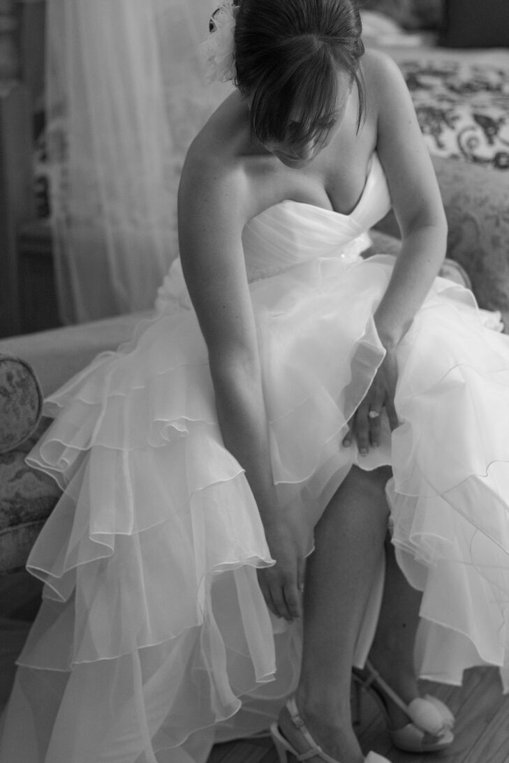 Bride Getting Ready in Strapless Mermaid Wedding Dress with Ruffled Tulle Skirt