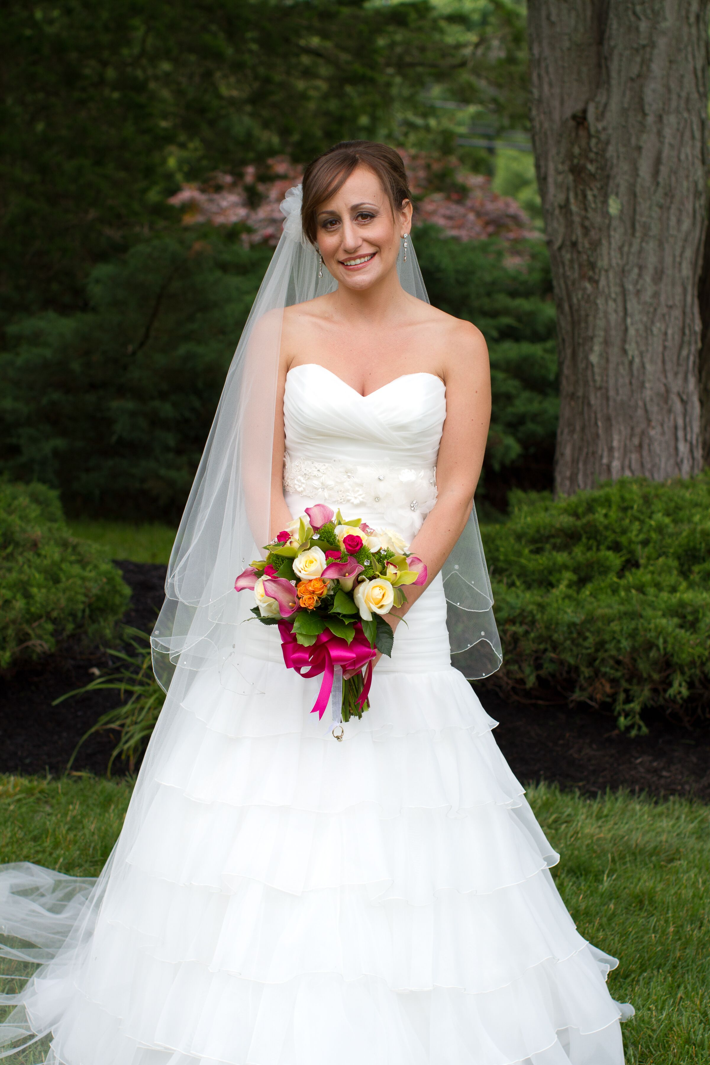 Bride In Strapless Ruffled Mermaid Wedding Dress With Cathedral Veil
