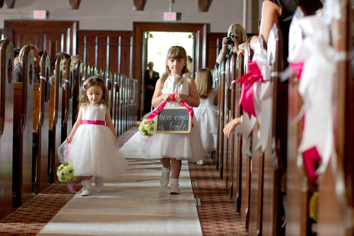 White Flower Girl Dresses with Pink Sashes and Chalkboard Sign