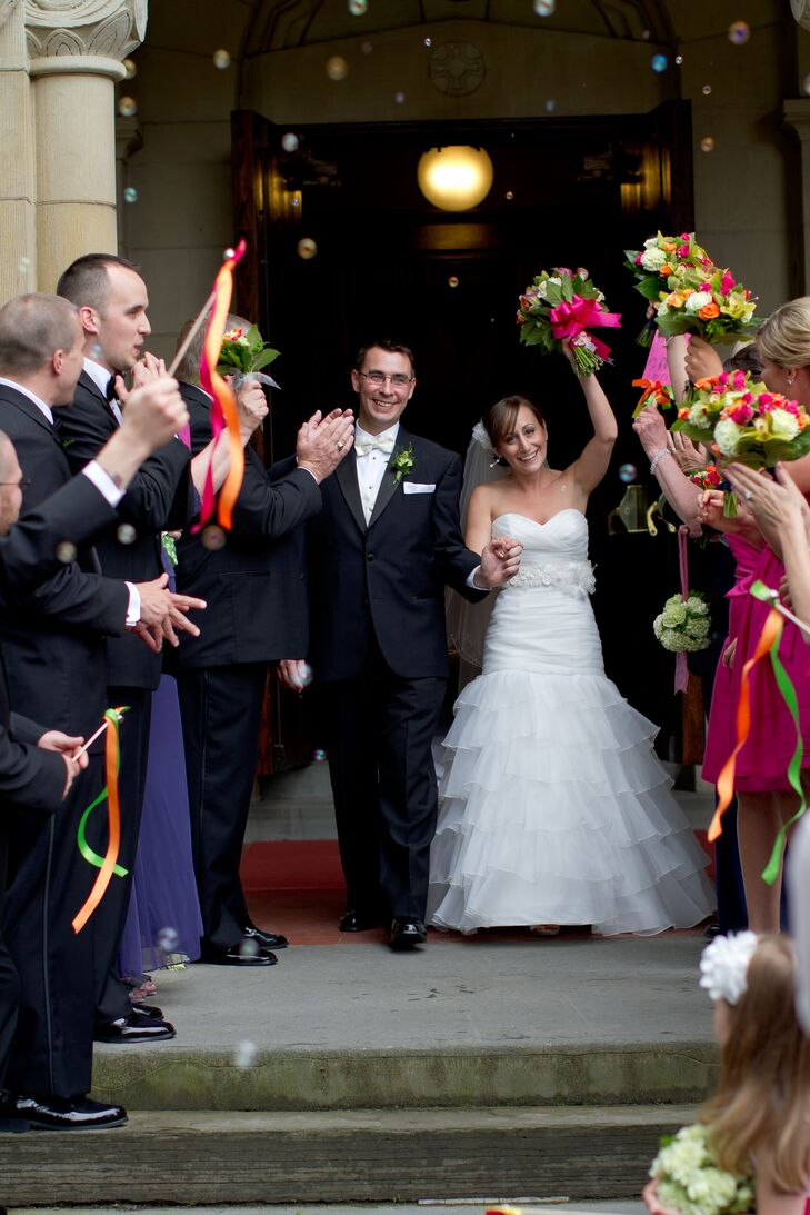 Nicole and Ben exited their ceremony at Vassar College Chapel to a shower of balloons. They also gave each of their guests a colorful ribbon wand to wave in enthusiastic celebration.