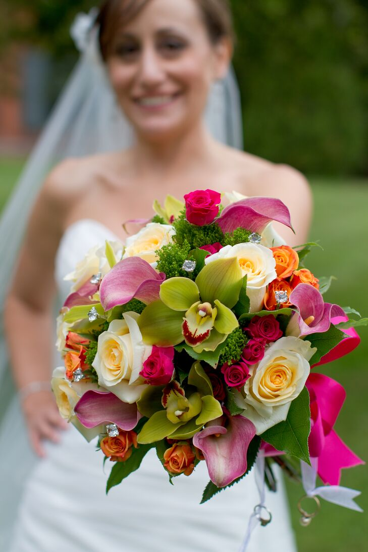 "The bridal bouquet incorporated green orchids with ivory and pink roses and hot pink calla lilies all held together by a bright pink ribbon. ""These color choices were inspired by summer and our vibrant personalities. Muted colors would not suit us well,"" Nicole says."