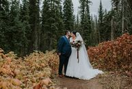 The stunning scenery took center stage at Christina	Parsons and Adam Galvine's rustic fall wedding. Their venue, Emerald Lake Lodge in British Columbi