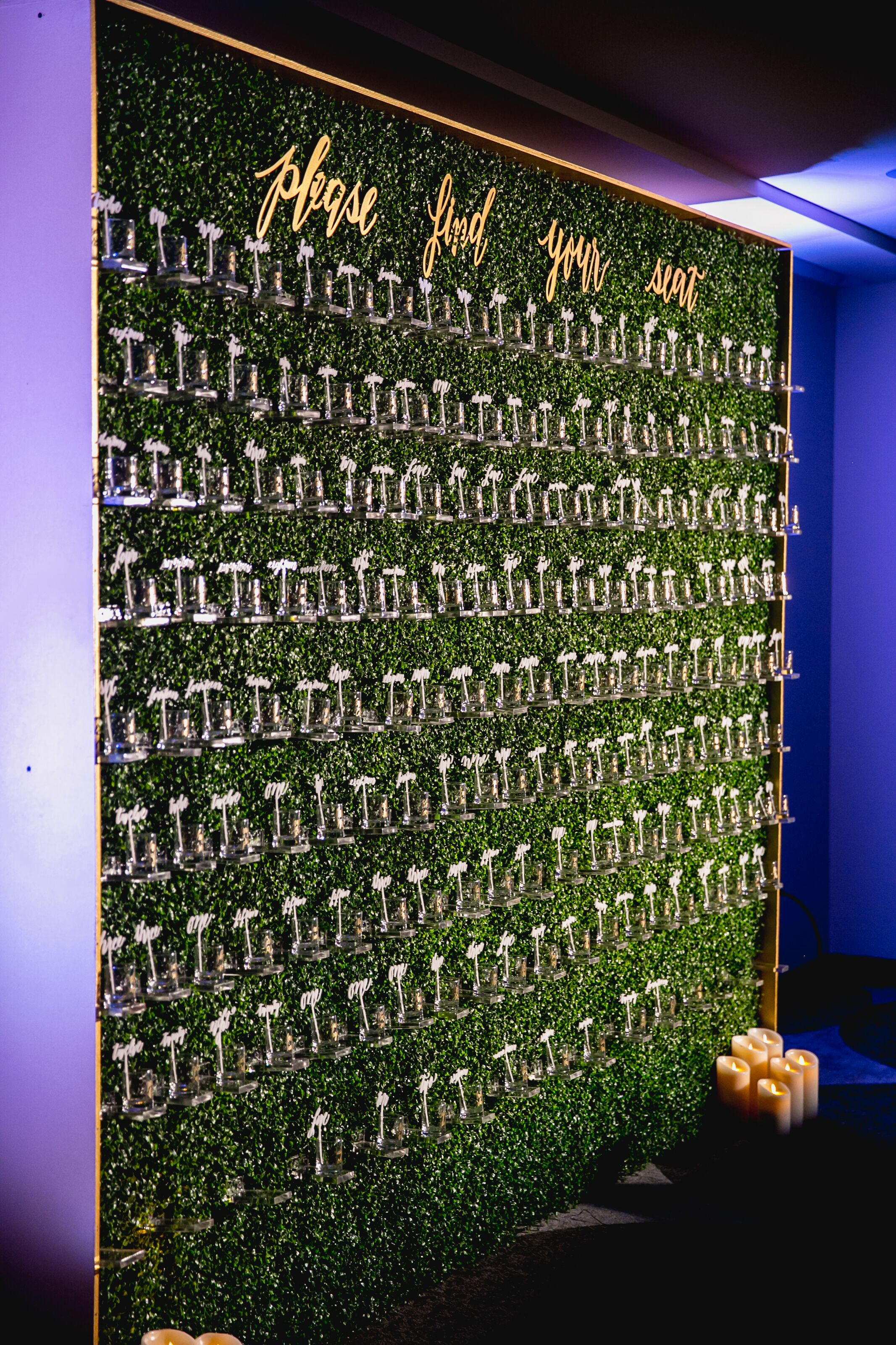 Escort Card Display On Hedge Wall