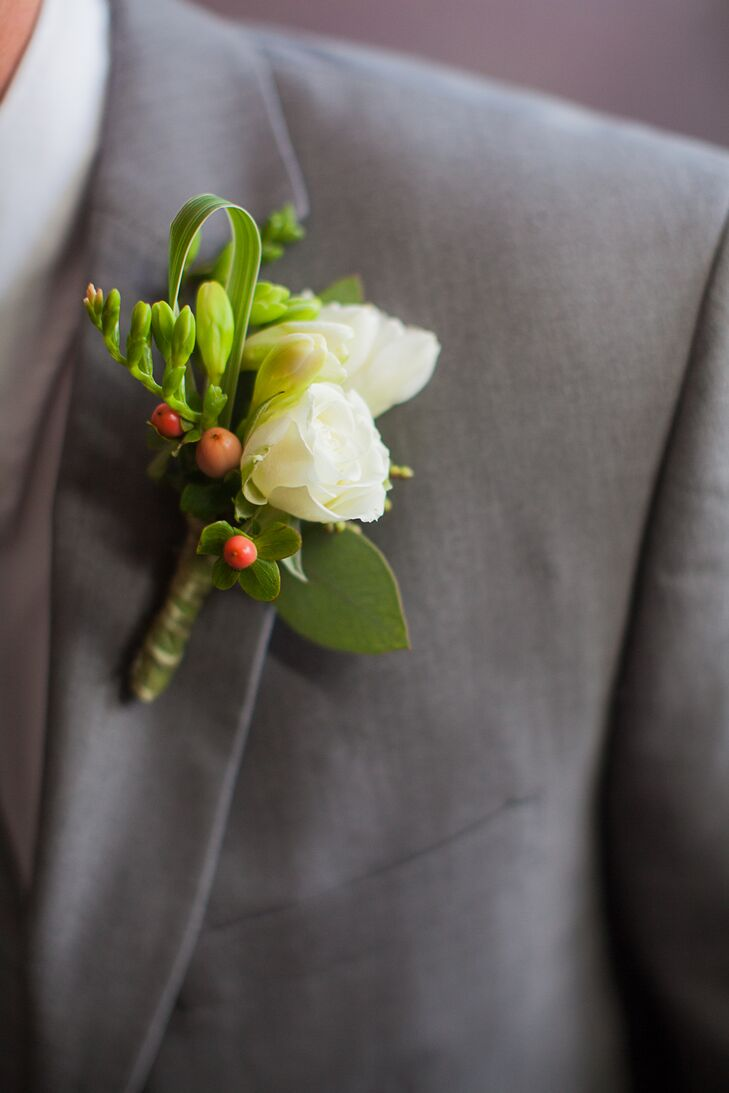 Morgan and his groomsmen wore white freesia boutonnieres, since that's the flower Morgan's father wore when he got married. The boutonnieres also included peach hypericum berries with greenery to tie into the theme.